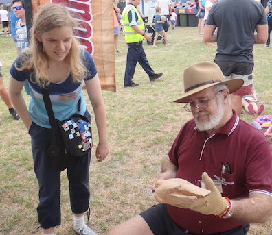 Dave whittling watched by a member